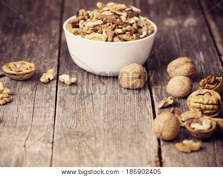 the walnuts on old dark wooden background