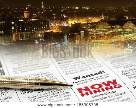 Newspaper Career Opportunity Ad with pen on night city background
