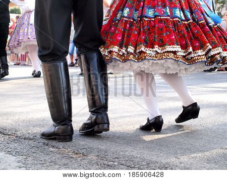 Hungarian folk dancers in ruffled skirt and boots