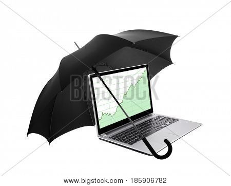 Laptop with stock charts protected by an umbrella