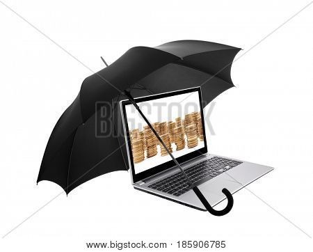 Laptop with golden coins protected by an umbrella