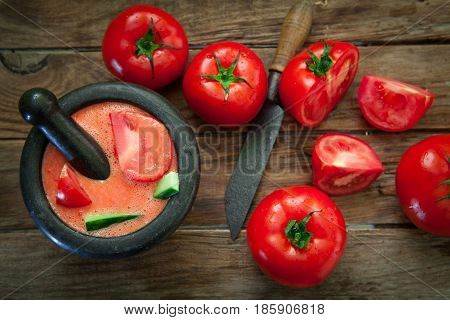 Preparing spanish cold tomato soup gazpacho style