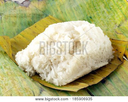 closeup loaf of sticky rice on banana leaf, main food in the northeast of Thailand