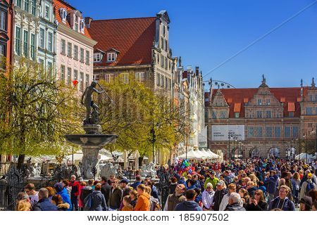 GDANSK, POLAND - MAY 2, 2017: Fountain of the Neptune in old town of Gdansk, Poland. The bronze statue of Neptune made in 16th century is one the most recognizable symbols of Gdansk.