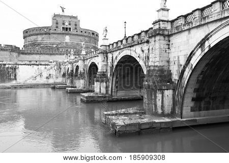 Bridge of St Angel and Castle of the Holy Angel (Castel Sant Angelo) in Rome. Black and white image