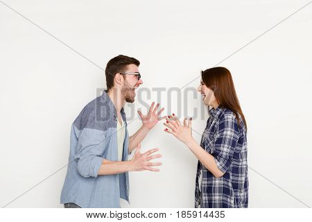 Relationship problems. Young couple arguing, yelling on each other because of disagreements, isolated on white