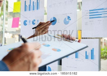 Business concept. Business people discussing the charts and graphs showing the results of their successful teamwork.