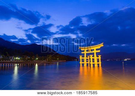 Torii in Itsukushima shine during sunset