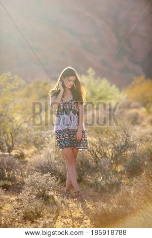 Portrait Of Young Woman In Red Rock, Nevada, Usa