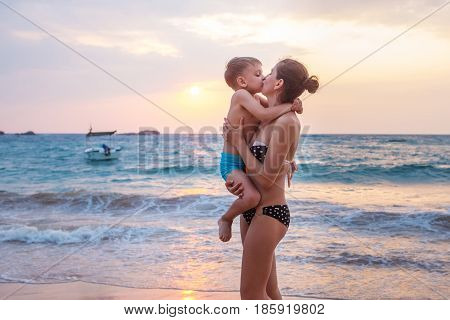 A Family Is Having Fun At The Seashore