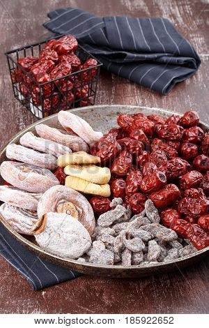 Dried fruits - persimmon figs red dates or jujube and salted sliced plum.