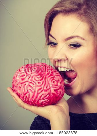 Crazy Woman Holding Brain Wanting To Eat It