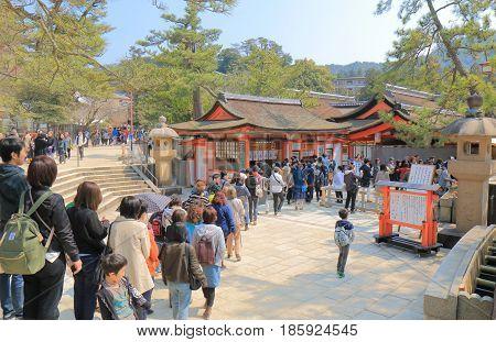 HIROSHIMA JAPAN - MARCH 19, 2017: Unidentified people queue to buy admission for Itsukushima shrine in Miyajima.