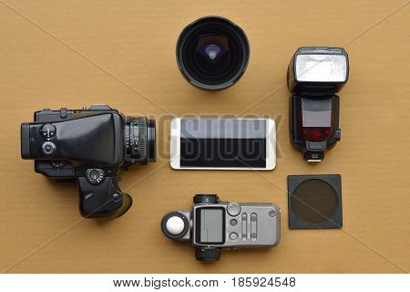 High resolution image of photographers equipment shot in studio on brown background
