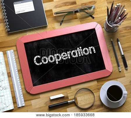 Cooperation Handwritten on Small Chalkboard. Cooperation. Business Concept Handwritten on Red Small Chalkboard. Top View Composition with Chalkboard and Office Supplies on Office Desk. 3d Rendering.