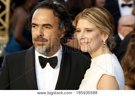 Alejandro Gonzalez Inarritu and Maria Eladia Hagerman at the 88th Annual Academy Awards held at the Hollywood & Highland Center in Hollywood, USA on February 28, 2016.
