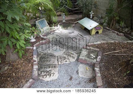 KEY WEST USA - AUG 27 2014: graveyard for the cats in Earnest Hemmingways garden. The cats are named like famous actors.
