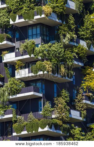 MILAN ITALY - APRIL 28 2017: Detail of the Bosco Verticale in Milan Italy. It is a pair of residential towers in the Porta Nuova district of Milan that host more than 900 trees.