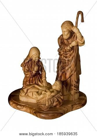 The Holy Family statue, wooden Carved sculpture of the Virgin Mary, Joseph and baby Jesus, isolated on white background.