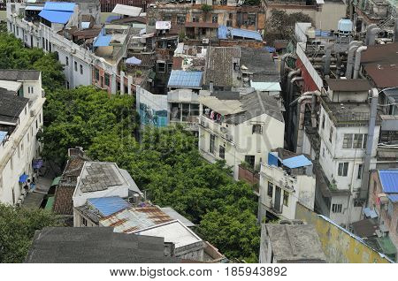 Weathered buildings and apartments on Shang Xia Jiu Pedestrian Street in the Xiguan district in the city of Guangzhou China on an overcast day in Guangdong province as seen from above.