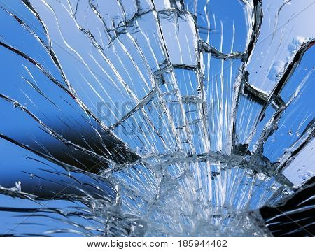 texture of shiny blue mirror surface with small and large cracks