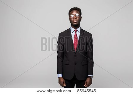 Handsome African Man Looking At Camera While Standing Against Grey Background