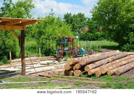 Small sawmill in the open air, Russia