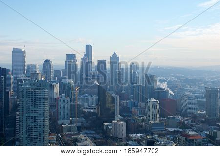 SEATTLE, WASHINGTON, USA - JAN 23rd, 2017: skyline of downtown Seattle, view from the top of the Space Needle during a cloudy day.