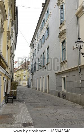 GRAZ, AUSTRIA - MARCH 19, 2017: Narrow street in the old town of Graz the capital of federal state of Styria Austria.