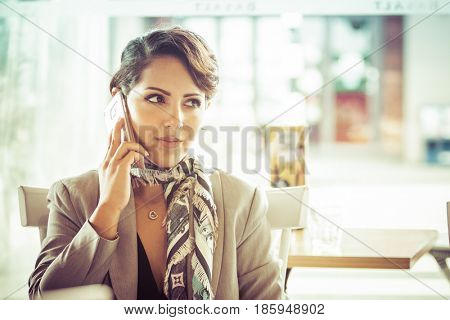 Middle eastern woman talking on phone
