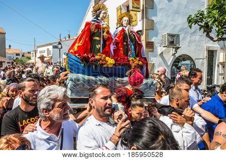 Saintes-Maries-de-la-Mer, France - May 25, 2015.  The concept of ethnographic tourism. The crowd is accompanied by two statues of the Holy Maries to the seashore. Religious feast