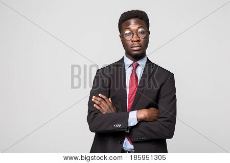 Portrait Of African American Business Man With Folded Arms, Isolated On Greybackground