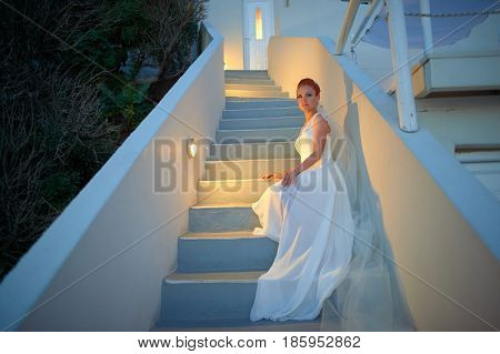 Outdoor shot of young beautiful red-haired bride