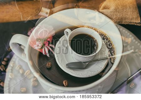 Double exposure of coffee cup, coffee beans, cup of hot coffee. Concept of Double coffee, Endorphins and good mood