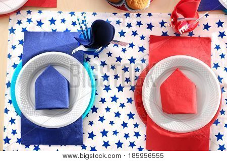 Table setting with plastic ware for summer picnic