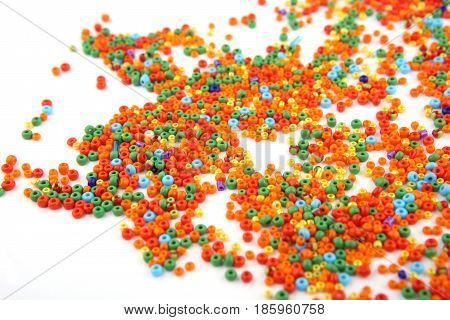 Colorful beads on white background. Abstract glass jewellery beads pattern.