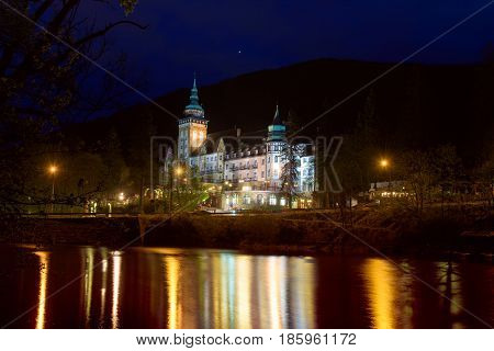 Lillafured palace in Miskolc, Hungary in the night. Lake Hamori in foreground with reflections. Travel outdoor landmark background
