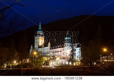 Lillafured palace in Miskolc, Hungary at night with illumination. Travel outdoor hipster landmark background