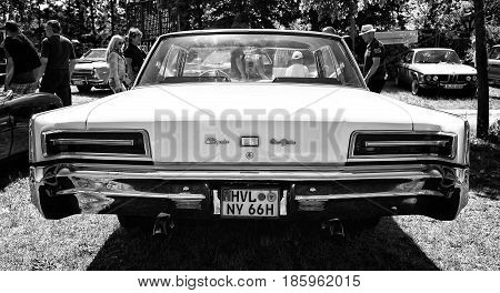 PAAREN IM GLIEN GERMANY - MAY 19: American full-size car Chrysler New Yorker Hardtop (1966) black and white rear view