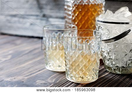Bourbon Whiskey In Glass On Wooden Background