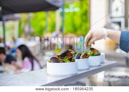 A Portion Of Cooked Mussels On A Plate. Outdoor Food On The Terrace.