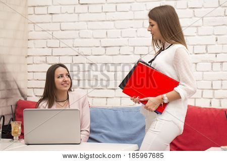 Beautiful Young Woman Comes To A Meeting Where She Waits Her Fellow Actress