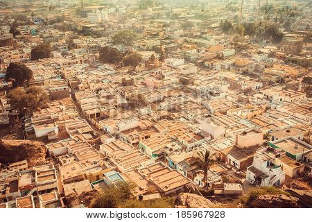 Aerial view on city Badami with stone houses and narrow street in state Karnataka. Cityscape of India.