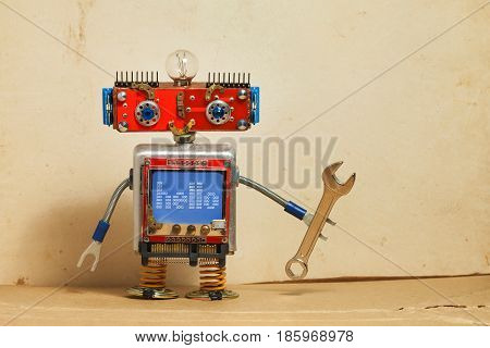 Steampunk machinery robot, smiley red head, blue monitor body. Handyman electrician retro toy, message hello display computer screen, hand wrench. Service repair fix concept. Vintage paper backdrop.