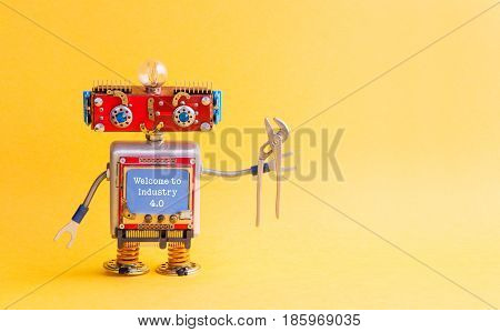 Welcome to industry 4.0 concept. IT specialist steampunk machinery robot, smiley red head, blue monitor body, pliers. New economic future message on blue display. Yellow background, copy space.