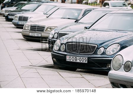 Batumi, Georgia - May 27, 2016: Different Cars Mercedes-Benz E-Class W210 And W211 Parked In Row In Street on Summer Day.