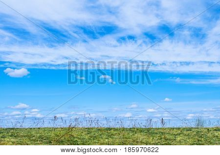 Blue Sky For The Background And White Cirrus, Cirrus-like Clouds Under The Field And Grass.