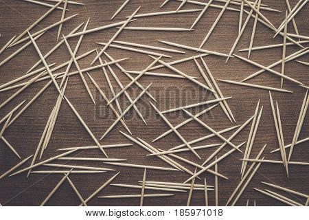many wooden toothpicks on the brown table texture