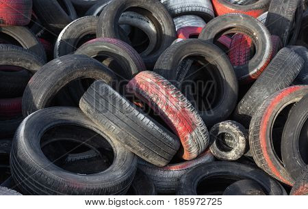 Variety of waste tyres dumped in a big pile