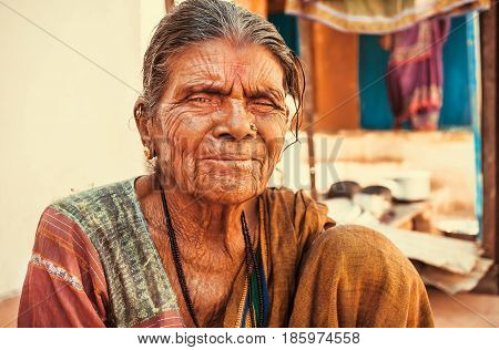 BADAMI, INDIA - FEB 8, 2017: Older asian woman with kind wrinkled face living in indian village on February 8, 2017. Population of Karnataka state is 62000000 people